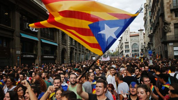 Supporters fly Catalonia's independent flag as Spain plunges into its worst political crisis since an attempted military ...