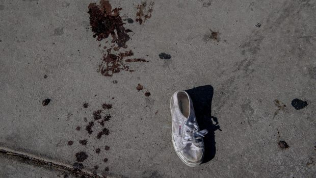Blood and a lost shoe down the street from the Mandalay Bay Resort.