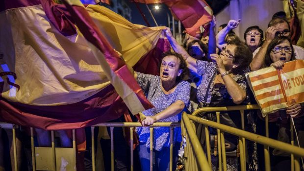 Anti-separatist demonstrators fight back as some of the region's largest companies shift their head offices elsewhere ...