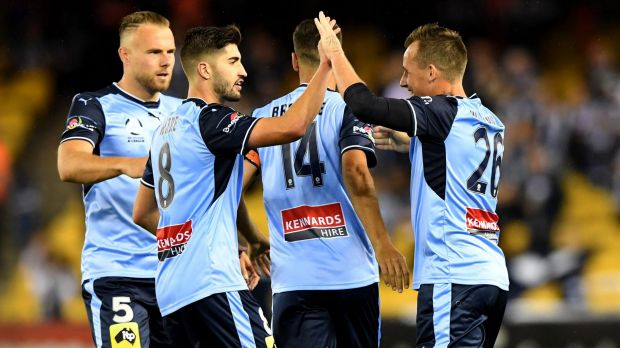 Sydney celebrates after the own goal which decided the result.