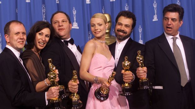 Harvey Weinstein (third from left) on stage at the 1999 Academy Awards celebrating the success of Shakespeare in Love, ...