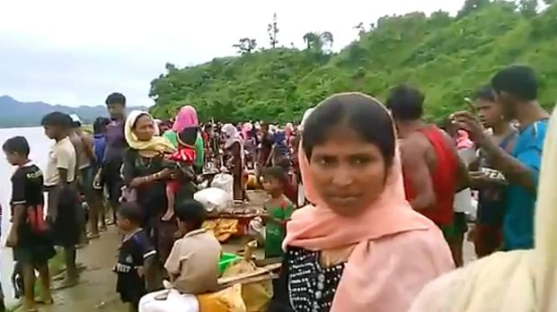 Video released by Arakan Rohingya National Organisation shows villagers preparing to cross a river towards the Maungdaw ...