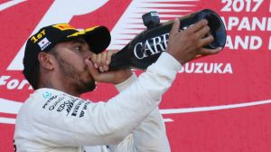 Champagne showers: Lewis Hamilton celebrates a win and essentially locking in the title.