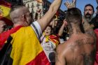 Demonstrators react during a protest for Spanish unity on the Marqus de la Argentera Avenue in Barcelona, Spain, on ...