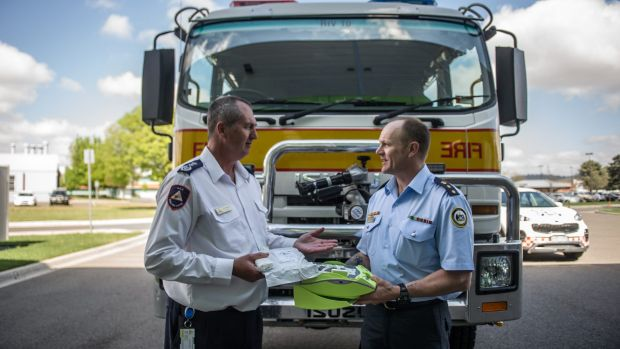 ACT Rural fire service Chief Officer Joe Murphy SES senior manager Operations and governance Rob Thompson inspect the ...
