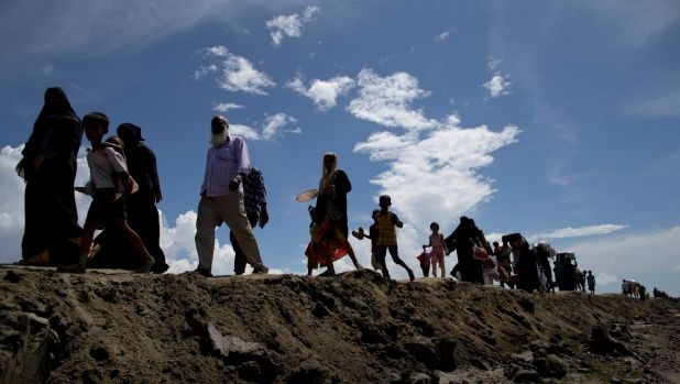 Newly arrived Rohingya Muslims from Myanmar walk as they continue their journey in to a camp for refugees in Teknaf, ...