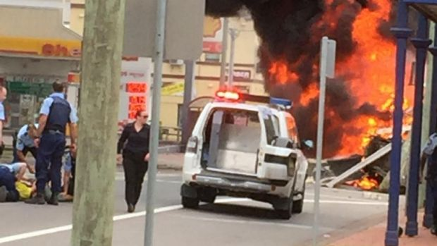 Police pinned the driver down as a fireball erupted nearby.