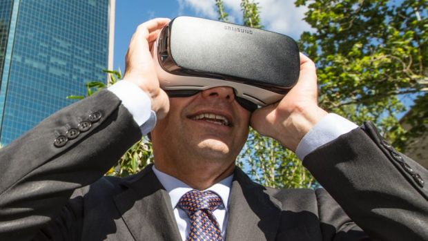 The Assistant Minister for Cities and Digital Transformation, Angus Taylor, looks at a virtual reality version of ...