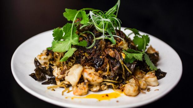 Stir-fry prawn, bug tail, egg noodle, garlic chive and hellfire chilli oil.