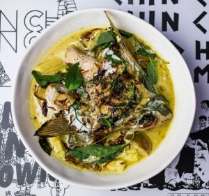 Go-to dish: Green curry with grilled fish wing, pea eggplant and baby corn.