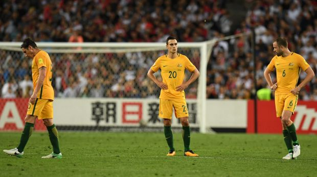 A dejected Mark Milligan, Trent Sainsbury and Matthew Jurman (right) against as the Socceroos struggled against Syria.