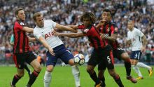 Tottenham's Harry Kane, second left, appeals for a penalty as he competes for the ball with Bournemouth's Dan Gosling, ...