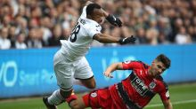 Swansea City's Jordan Ayew, left, and Huddersfield Town's Christopher Schindler clash in action during their English ...
