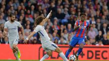 Chelsea's David Luiz, left, vies for the ball with Crystal Palace's Wilfried Zaha during their English Premier League ...