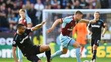 Burnley's Johann Berg Gudmundsson, right, and West Ham United's Winston Reid battle for the ball during their English ...