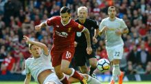 Manchester United's Nemanja Matic, left, and Liverpool's Philippe Coutinho, second from left, battle for the ball during ...