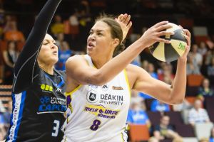 Capitals forward Mistie Bass tries to defend against Boomers centre Liz Cambage.