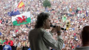 Bob Geldof, LIVE 8 organiser, invites the festival crowd to link hands in support of the Make Poverty History campaign, ...