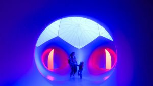 "Visitors dance under a dome while browsing the ""luminarium"" designed by artist Alan Parkinson as part of the ""Architects ..."