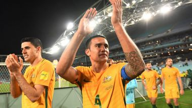 Next stop Central America: Australia's Tim Cahill (centre) and Tomas Rogic acknowledge the crowd after their win over ...