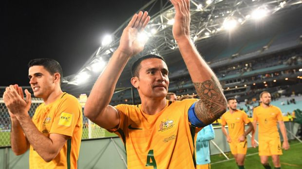 Australia's Tim Cahill (centre) and Tomas Rogic (left) applaud the crowd after their win over Syria at ANZ Stadium in ...