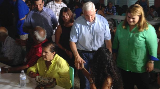 Vice-President Mike Pence greets community members at a meal following church services in San Juan, Puerto Rico.