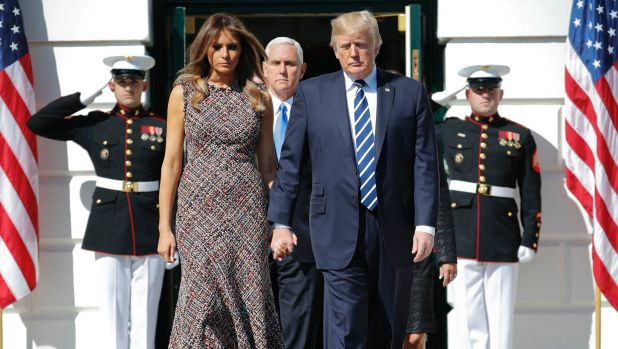 US Vice-President Mike Pence walks right behind his commander-in-chief, President Donald Trump and first lady Melania Trump.