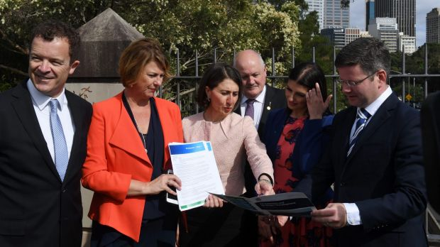 Premier Gladys Berejiklian and Roads Minister Melinda Pavey, second from left, have committed to the first three stages ...
