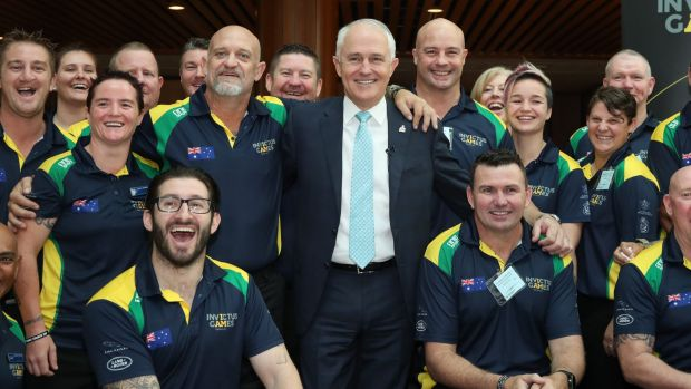 Prime Minister Malcolm Turnbull with athletes returning from the Invictus Games.