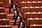 Attendants serve tea ahead of the opening of the 19th National Congress of the Communist Party of China at the Great ...