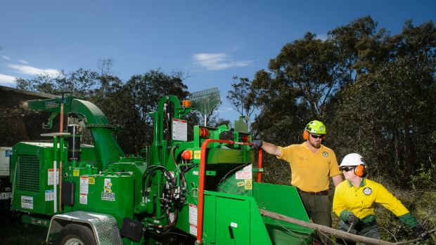 Seasonal fire crews use a chipper in their bid to reduce the fire hazard in Bruce bushland.