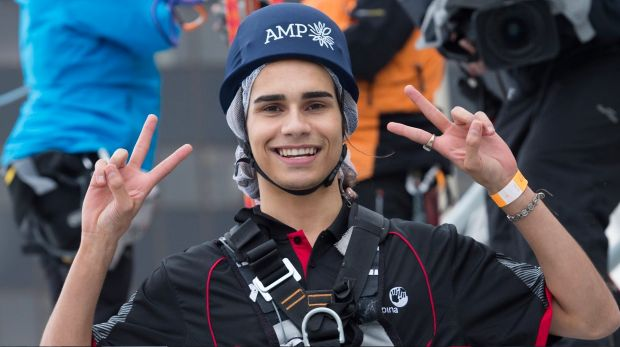 Isaiah Firebrace descends on a zipline from the AMP tower in Sydney on Friday.
