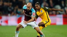 West Ham's Pablo Zabaleta, left, and Brighton's Jose Izquierdo challenge for the ball during the English Premier League ...