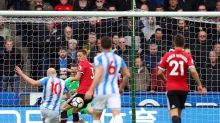 Huddersfield Town's Aaron Mooy, left, scores his side's first goal of the game during the English Premier League soccer ...
