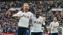 Tottenham's Harry Kane, center, celebrates after scoring his side's first goal during the English Premier League soccer ...