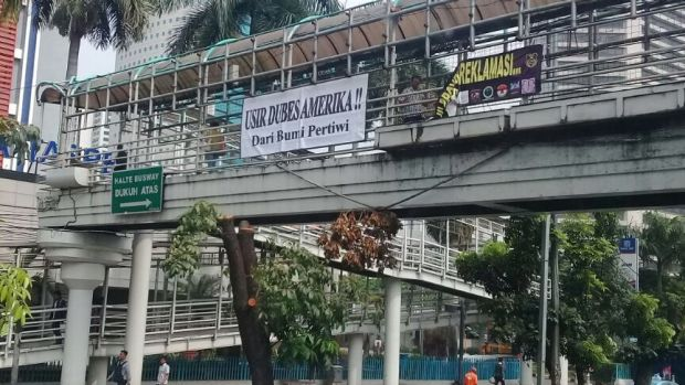 "A banner in Jakarta saying: ""Expel the American ambassador from our land"" erected over major Jakarta thoroughfare on ..."