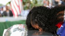 Myeshia Johnson kisses the casket of her husband, Sgt. La David Johnson during his burial service at Fred Hunter's ...