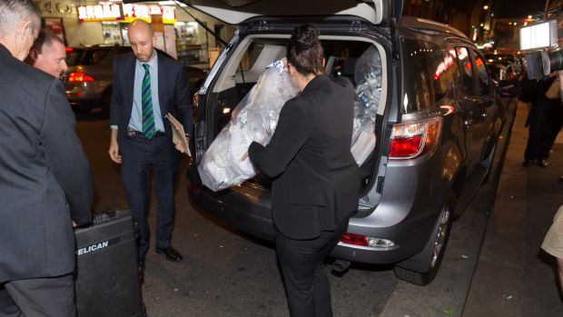Australian Federal Police remove shredded documents and other evidence during a raid on the Australian Workers Union ...