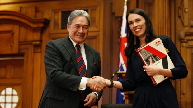 New Zealand First leader Winston Peters, left, and Prime Minister-designate Jacinda Ardern shake hands after signing a ...