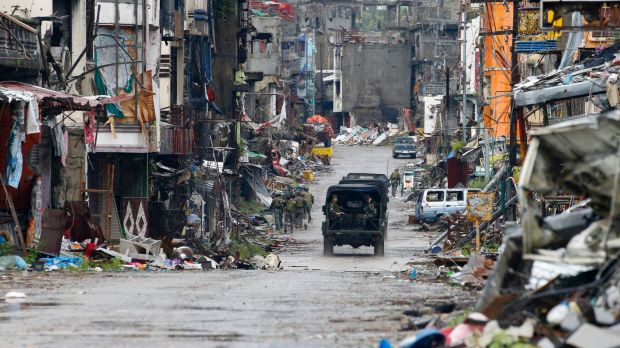 Philippine troops drive through Marawi last month after the city was declared liberated following a months-long siege ...