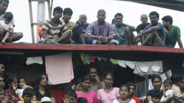 ''We are not animals. We are not dogs'' ... Sri Lankan asylum seekers on their boat in Cilegon, Banten province, in Indonesia