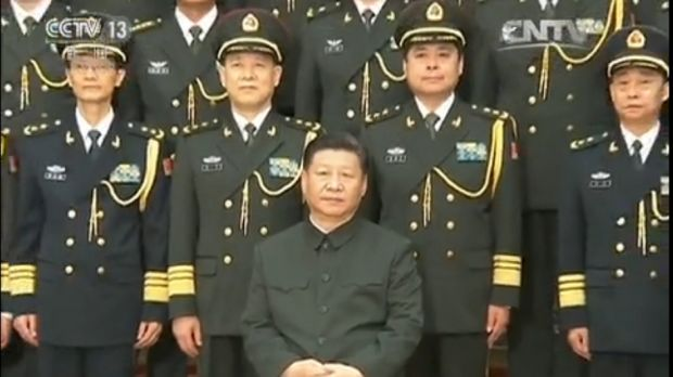Chinese President Xi Jinping (seated) with Lieutenant-General Yang Xuejun (second from right, front row).