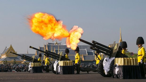 An artillery gun is fired at the funeral procession and royal cremation ceremony of late Thai King Bhumibol in Bangkok ...
