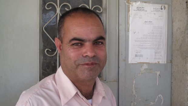 Khalil al-Amour with a notice of eviction pinned to the front door of his home in the Negev Desert village of al-Sira in ...