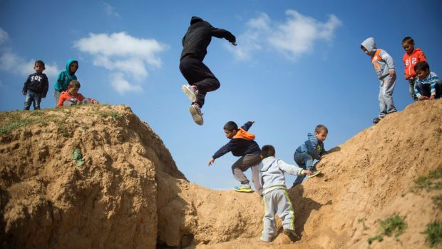 Israeli Bedouin children play before a rally marking the 40th anniversary of Land Day and against a plan to uproot the ...