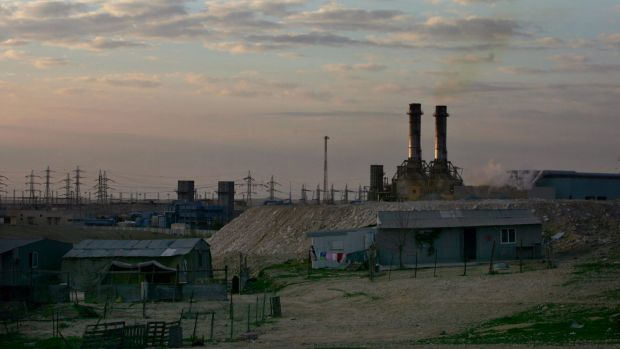 Bedouin homes sit in front of an Israeli power plant at Wadi al-Naam, near Beersheba.
