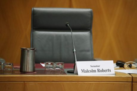 The chair reserved for Malcolm Roberts during a Senate hearing after the High Court judgement on his eligibility to be ...
