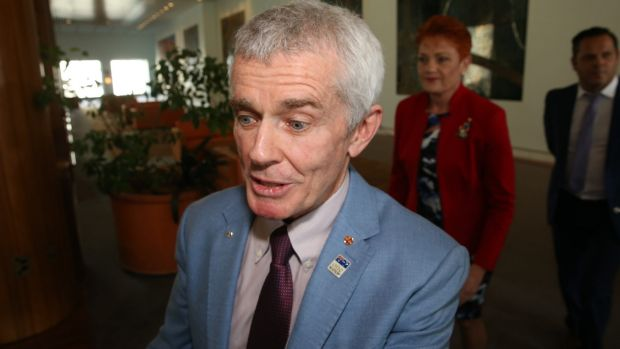 Malcolm Roberts with Pauline Hanson at Parliament House in Canberra on Friday after the High Court booted him from the ...