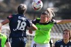 Melbourne Victory's Tiffany Eliadis and Canberra's Liana Danaskos compete.
