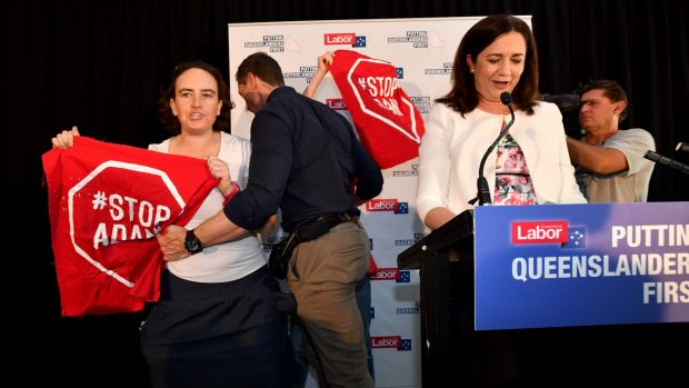 Adani protesters try to interrupt Queensland Premier Annastacia Palaszczuk on the first day of the recent state election ...